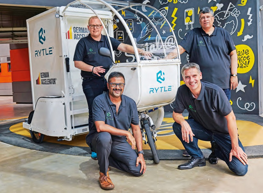 """The team gathered around Rytle CEO, Ingo Lübs (back left) and Dr Andreas Kruse (front right), introduces the """"MovR""""."""