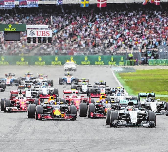 Die Formel-1-Rennen am Hockenheimring sind ein Event für die ganze Familie. Besonders die kleinen Besucher freuen sich, wenn sie ein Autogramm ihres Idols, wie hier von Sebastian Vettel, ergattern können. Bilder: Hockenheim-Ring GmbH