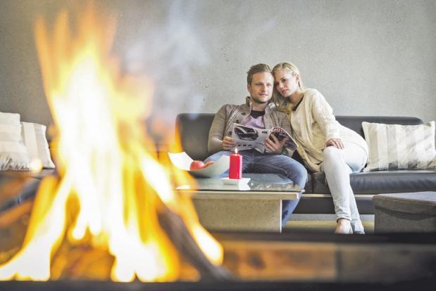Im Haus aus Beton lässt sich auch das offene Kaminfeuer entspannt genießen.                               Fotos (2): Betonservice Süd