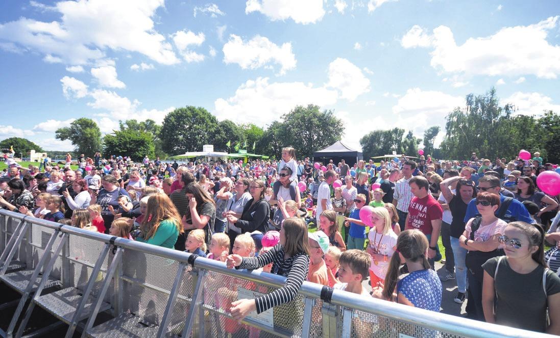 Das traditionelle Sommerfest lockt am 21. Juli wieder zahlreiche Familien in den Allerpark. Foto: Wolfsburg AG/ Jenko Sternberg Design