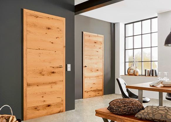 Der natürliche und vielseitige Baustoff fügt sich harmonisch in die Wohnlandschaft ein. Foto: epr/Gesamtverband Deutscher Holzhandel/GRAUTHOFF Türengruppe