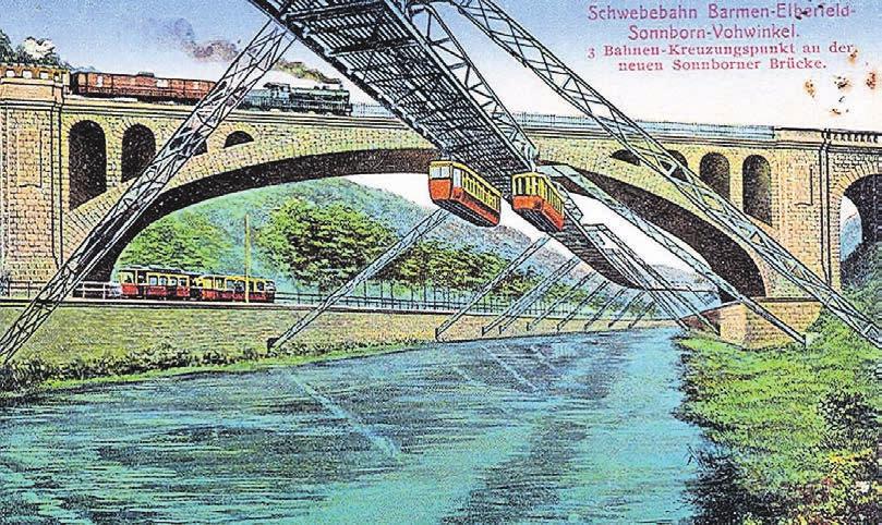 Auf dieser historischen Postkarte ist die markante Eisenbahnbrücke in Sonnborn zu sehen. Die Schwebebahnstrecke führt ebenso hindurch wie die heutige Friedrich-Ebert-Straße. Repro: Archiv Wolfgang Sauber