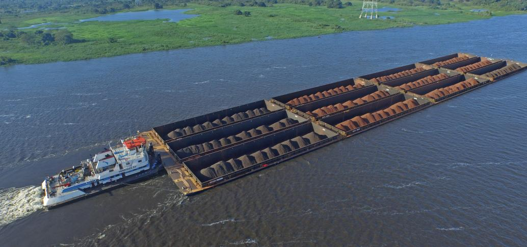 Large quantities of bulk goods are moved with push boat convoys on South American rivers.