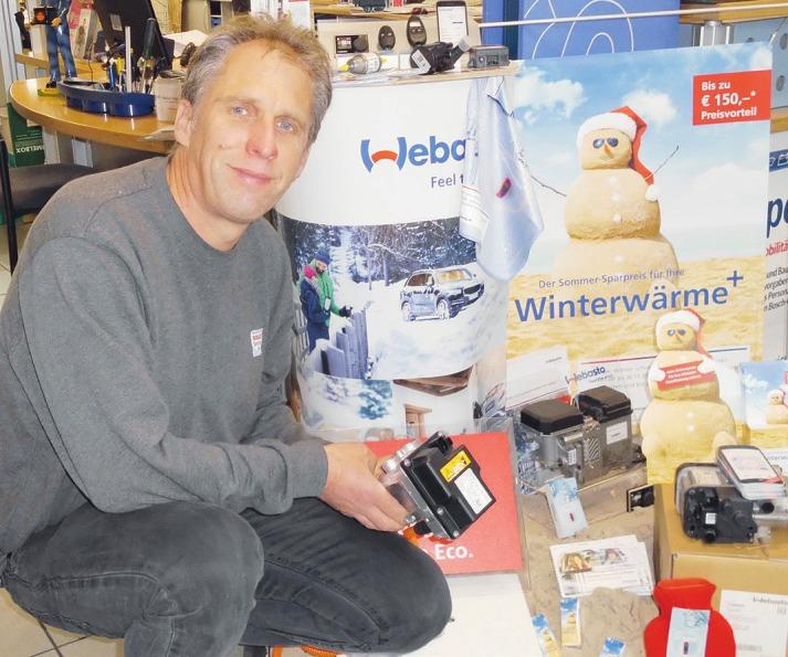Jörn Hellfritsch vom Bosch-Service in Pinneberg präsentiert eine Standheizung für Kurzstreckenfahrer Foto: Skibbe