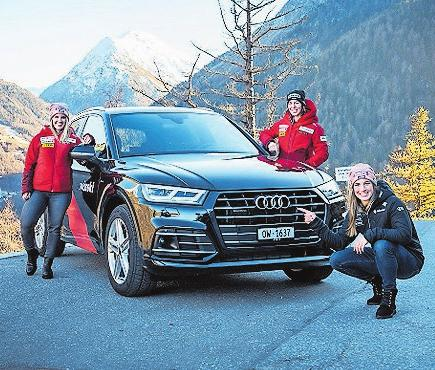 Joana Hählen, Michelle Gisin (vl.) und Jasmine Flury fahren einen Plug-in-Hybrid. Bild: PD