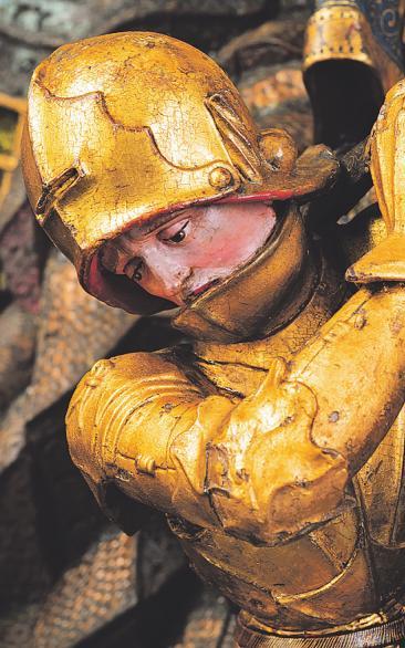 Mit goldener Rüstung kämpft der Ritter Georg