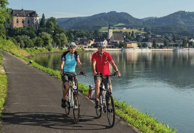 Entspanntes Radeln auf dem Donauradweg. Foto: WGD Donau Oberösterreich Tourismus GmbH / Erber