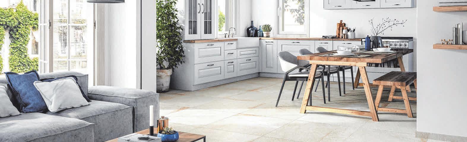 Fliesen in zeitlos hochwertiger Natursteinoptik passen hervorragend zu modernen Landhausküchen und bieten den bewährten Nutzungskomfort des Feinsteinzeugs. FOTO: DJD/DEUTSCHE-FLIESE.DE/VILLEROY&BOCH