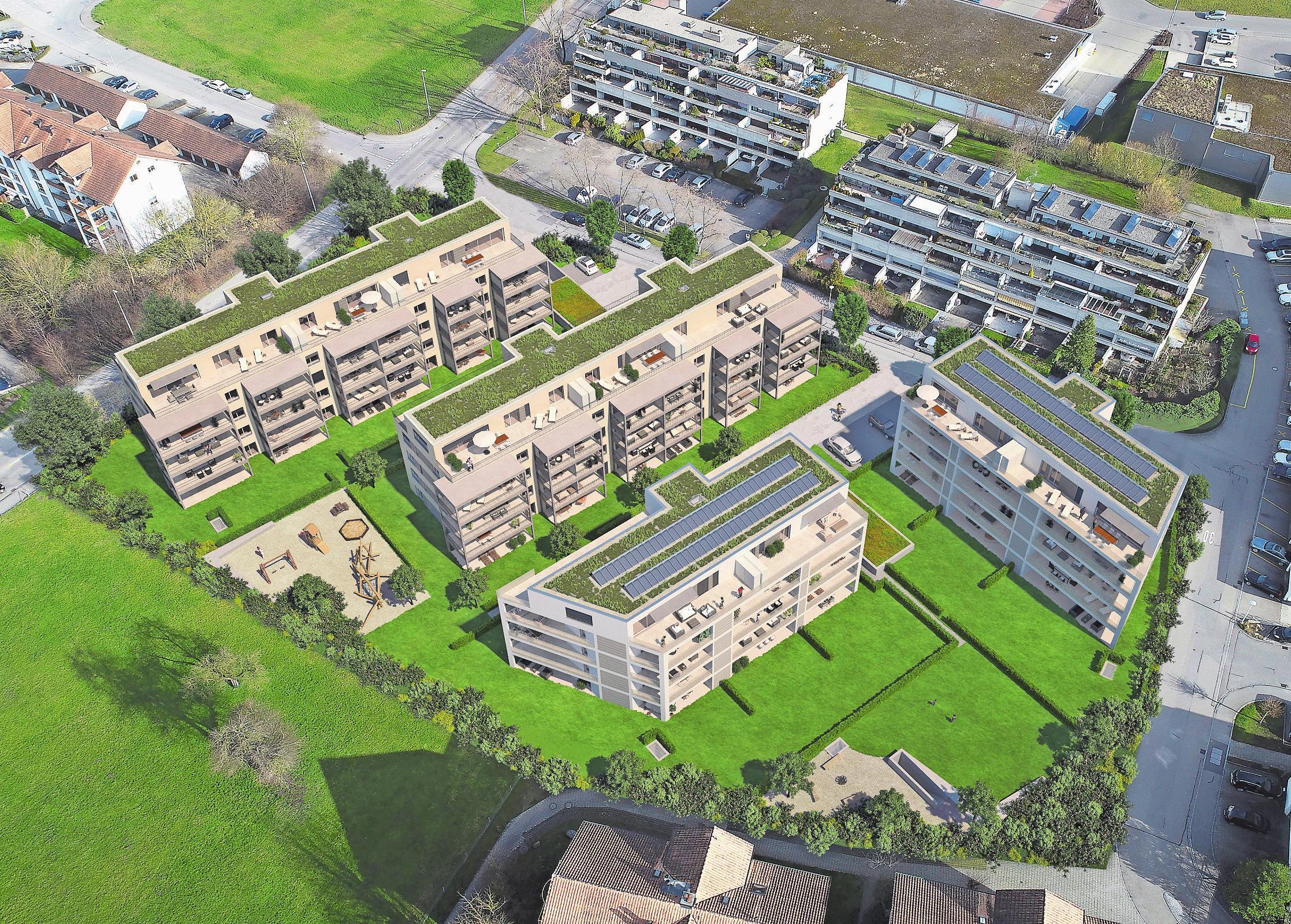 Die vier Mehrfamilienhäuser fügen sich perfekt in die Umgebung ein und bieten viel Grünfläche für ihre Bewohner. Bild: PD
