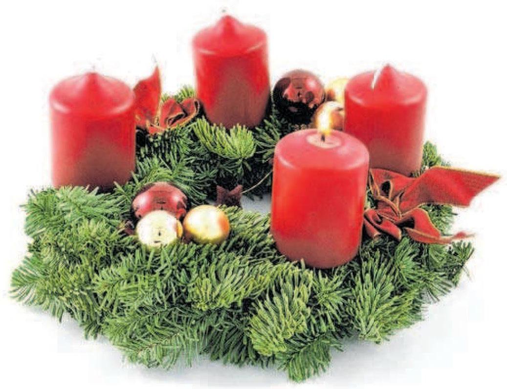 Der Schein von echten Kerzen sorgt für romantische Stimmung in der Zeit vor Weihnachten. Foto: © Thomas Vogt - Fotolia.com