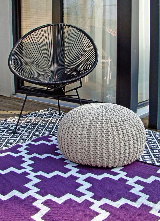 Wohnflair im Freien: Rug.it fertigt wetterfeste Teppiche aus PET-Flaschen. FOTO: RUG IT