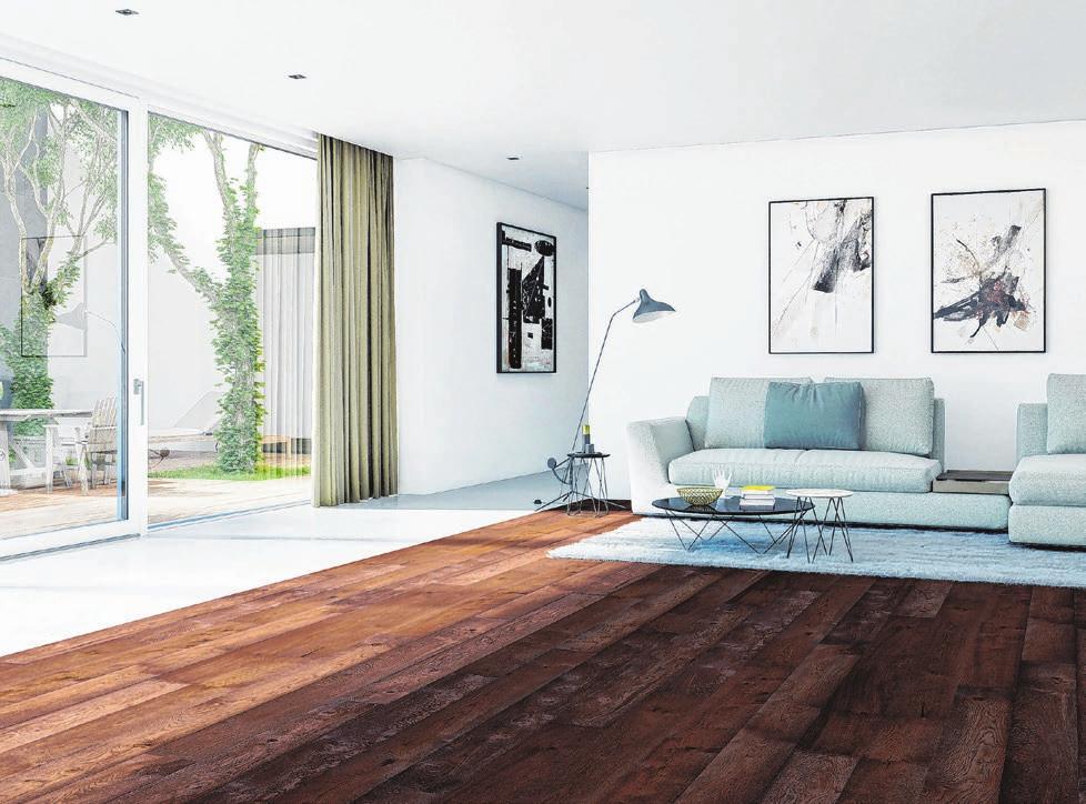 Dunkles Eichenparkett, kombiniert mit heller Einrichtung, schafft ein edles Ambiente, das zugleich wohnlich ist. Foto: HLC/Weitzer Parkett