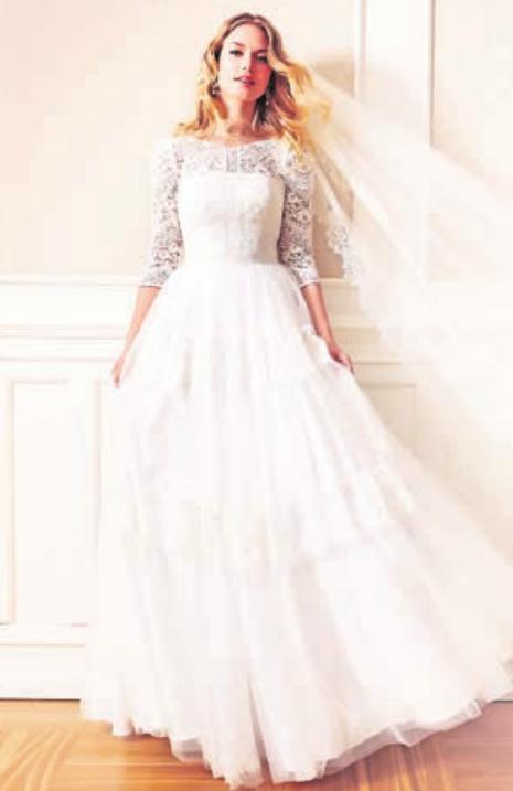 Oben eng anliegend und unten weit: So sieht 2019 das bevorzugte Brautkleid aus – hier im sogenannten Boho-Stil. Foto: Lilly