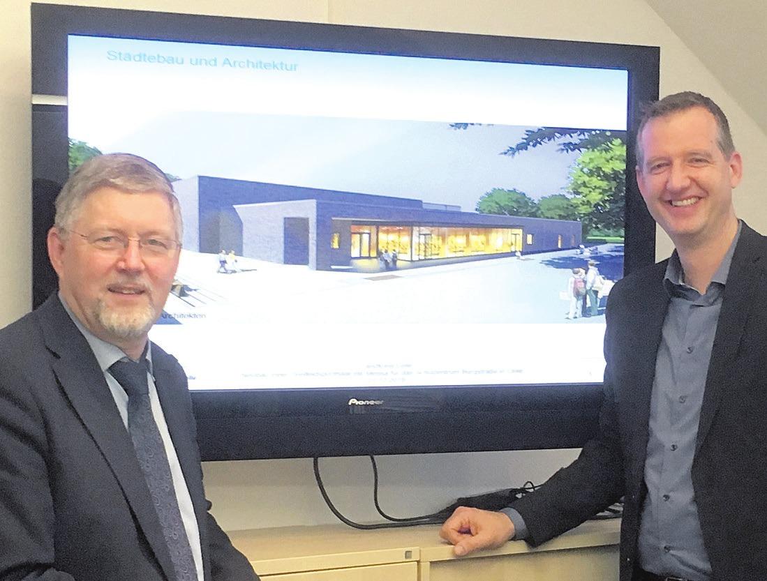 Schuldezernent Reinhard Toboll (links) und Jörg Bollmann, Geschäftsführer der Firma August Reiners Hochbau GmbH, zeigen eine Ansicht der neuen Halle mit Mensa für das Schulzentrum Burgstraße. Foto: Landkreis Celle