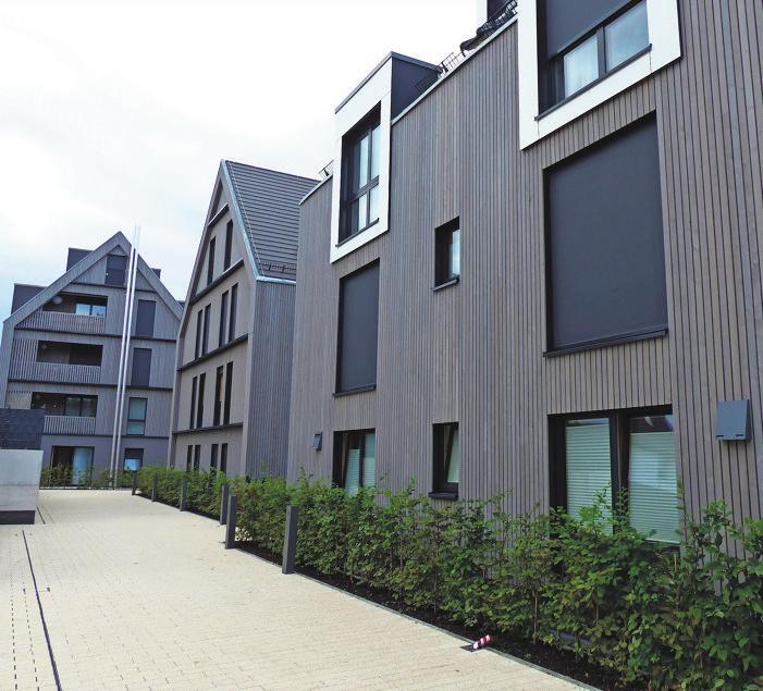 Moderne Holzfassaden setzen in der Neuen Mitte Schmiden Akzente. Fotos: Michael Käfer