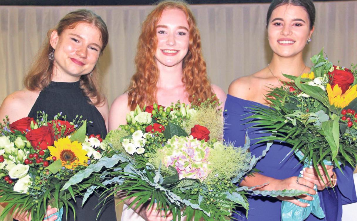 In einem Meer von Blumen: Die drei besten Dentalassistentinnen.