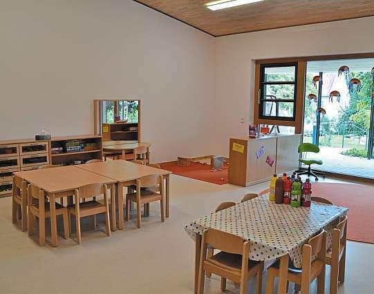 Lichtdurchflutetes Kinderhaus mit jungem Team Image 2