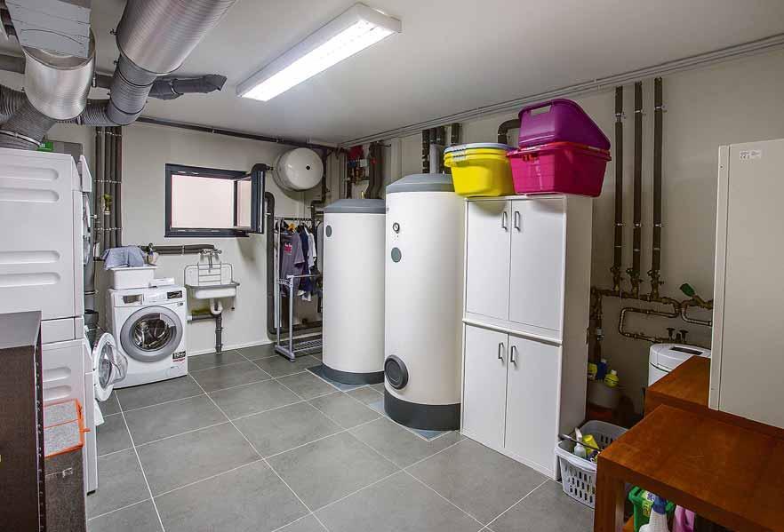 Der Technikraum ist die Schaltzentrale des Fertighauses. Er wird gerne im Keller untergebracht. Foto: BDF/WeberHaus