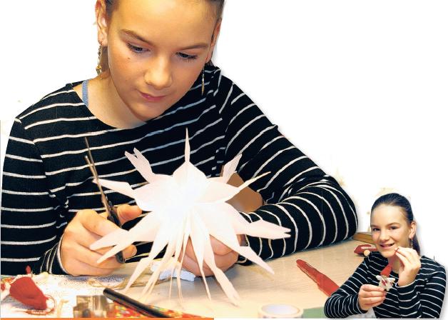 Die elfjährige Lucie macht es vor: Schon aus einfachem Papier lässt sich ein prachtvoller Weihnachtsstern basteln Fotos: C. Wessels