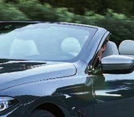 Warmluft aus der Kopfstütze erhöht das Offen-Fahrvergnügen. Foto: BMW AG