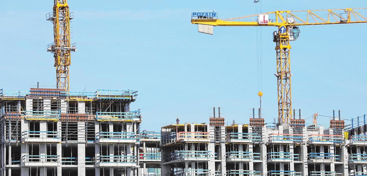 Baugenehmigungsprozesse dauern hierzulande laut des Zentralen Immobilien Ausschusses zu lange. BILD: CHRISTIAN CHARISIUS/DPA