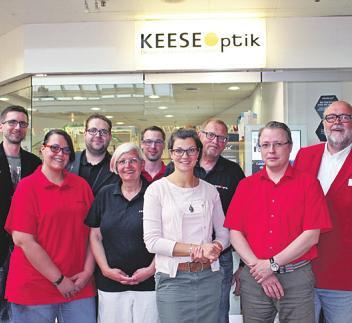 Norbert Keese und Team im Buchholzer City Center Foto: Keese